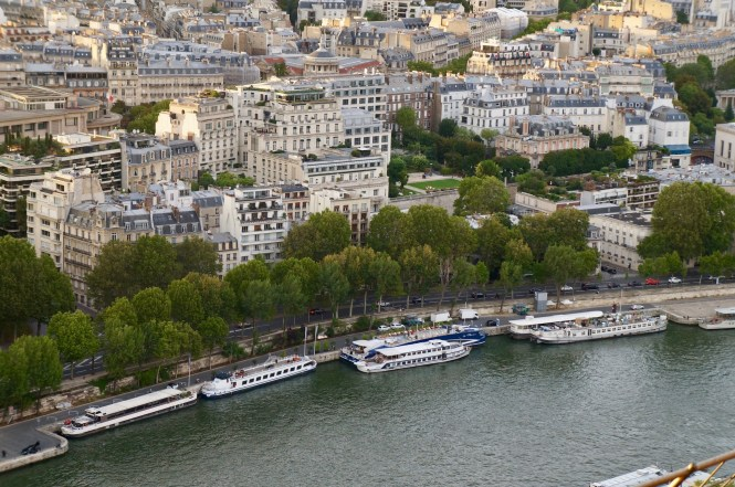 Climbing the Eiffel Tower Seine and Rooftops