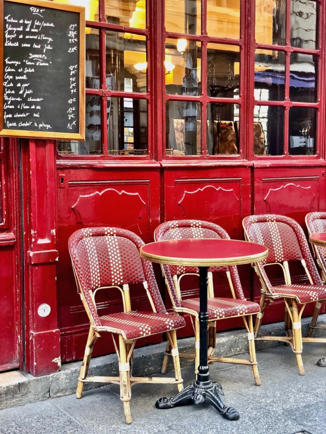 Why I Moved to Paris: red cafe chairs