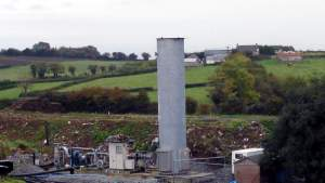 A landfill gas flare. The destination of landfill gas collection systems.
