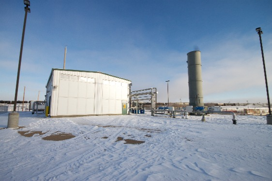 Image shows a landfill gas plant with an enclosed flare.