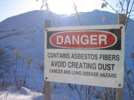 Image shows a hazardous construction waste type asbestos warning.