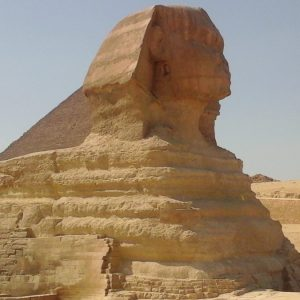 The Sphinx in Giza: A view of the Great Sphinx and the Pyramid of Khefrena when you are on a trip to Cairo from Hurghada