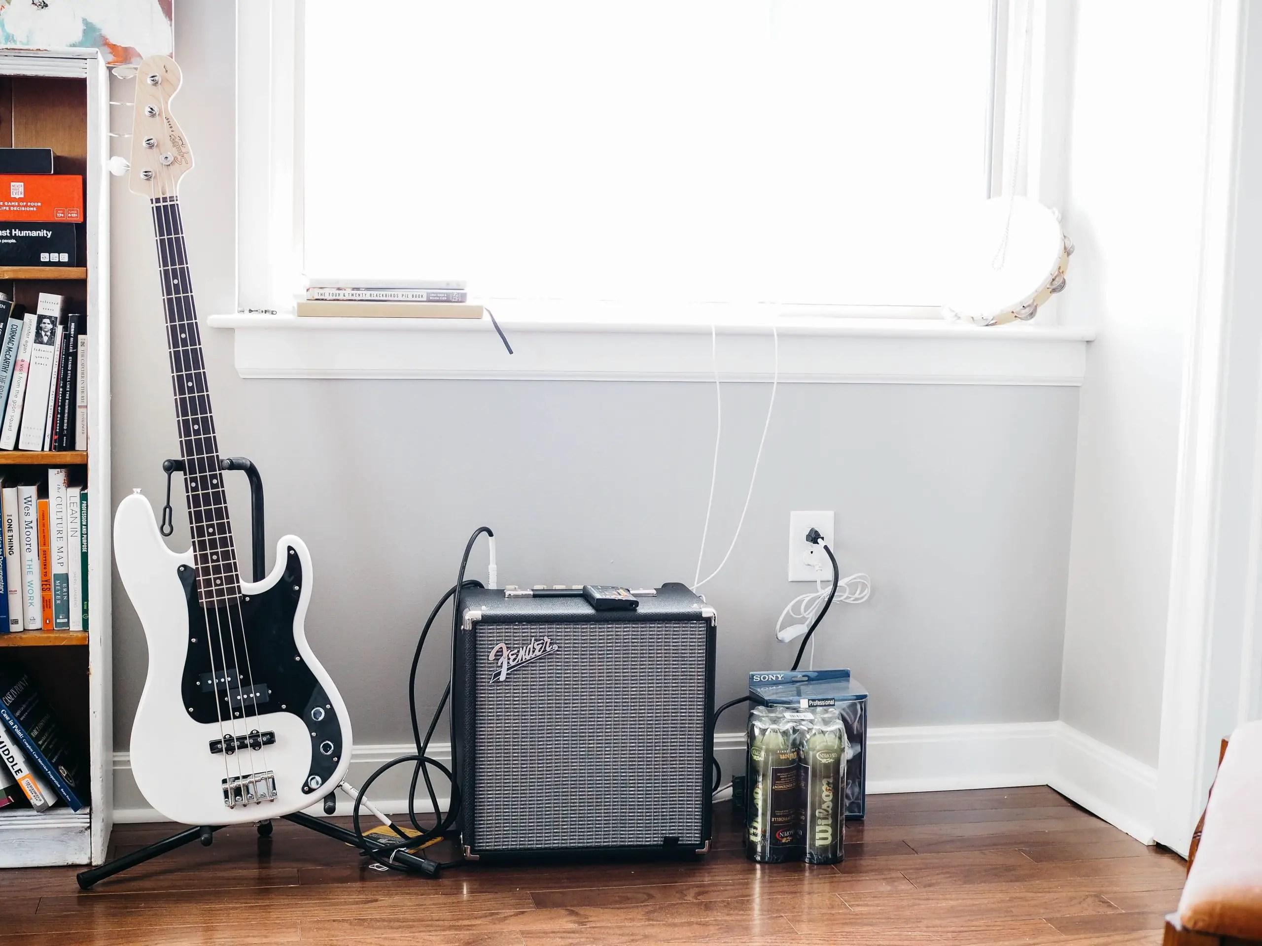 guitar by window in rental