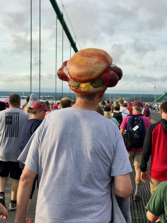 A walker in a hot dog hat. Why not?