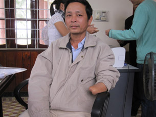 Phuong, who lost his left hand due to landmine explosion, now participates in mushroom growing program.