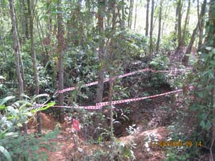 Bomb crater where cluster munitions tubes were found among acacia trees about 5 km from national Highway 1-A.