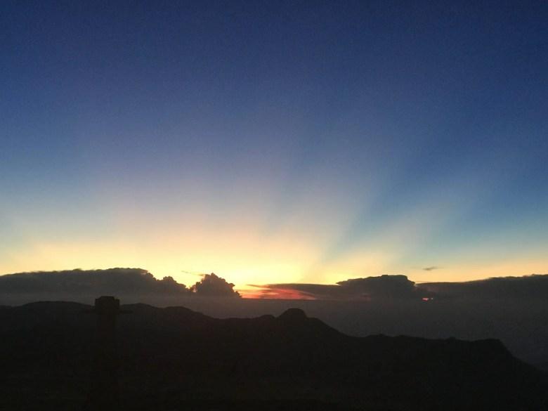 Sun starting to rise on Adam's Peak, Sri Lanka