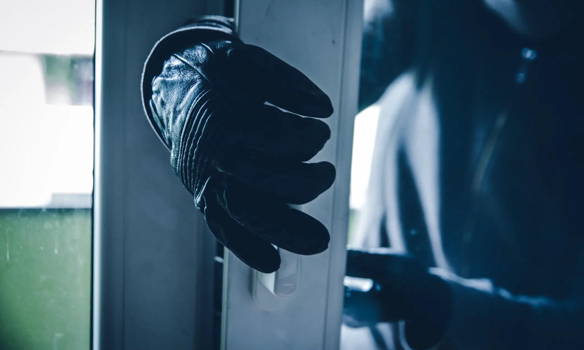 Burglar breaking into a home