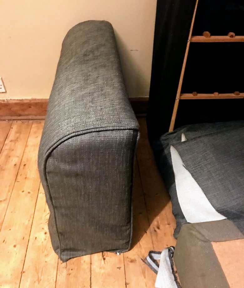 Piped sofa arm cover