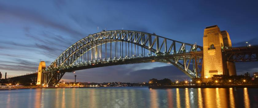A view of the iconic Sydney Harbor Bridge at Dusk