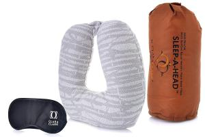 An image of a travel pillow and eye mask. One of the best travel accessories for long flights.