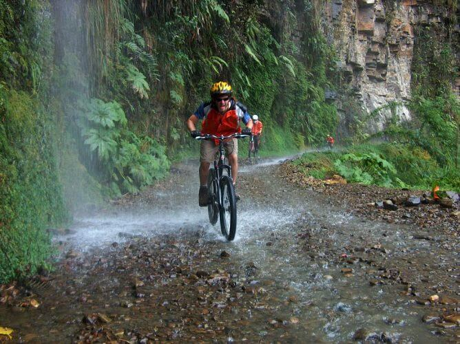 A picture of a cyclist heading down the Yungas road in Bolivia