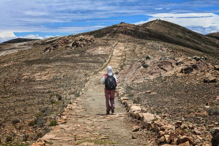A hiker on a path in isla del sol