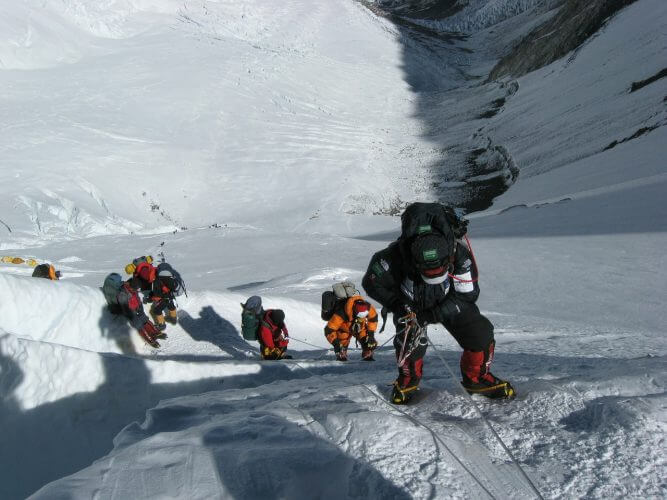 A group of climbers braving the conditions on everest