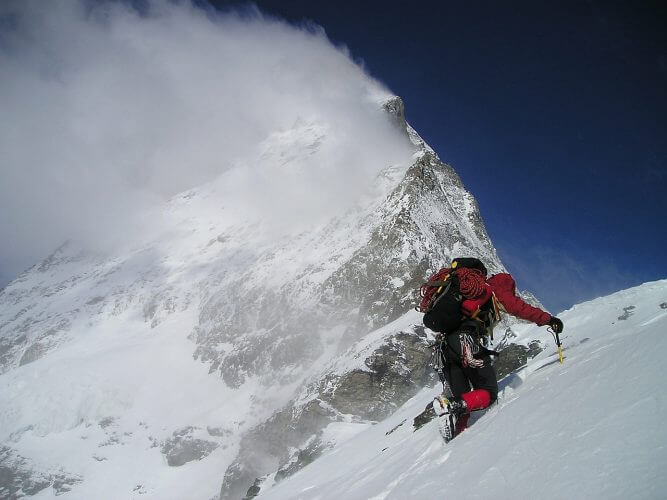 An image of a person climbing matterhorn is shown here