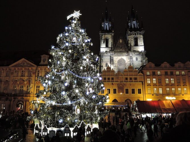 The christmas tree in the main square in prague is shown here