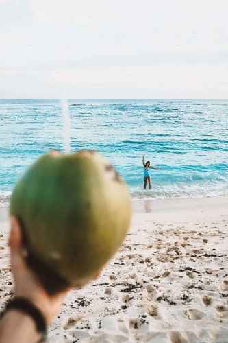 Sipping coconut on the beach