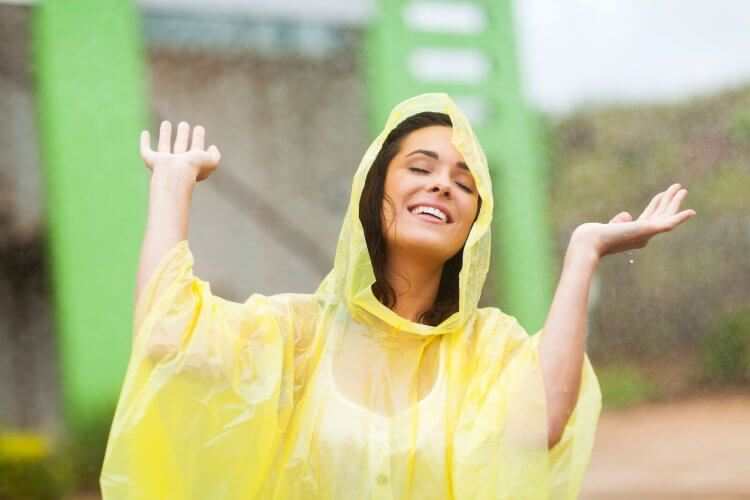 A girl wearing one of the best rain ponchos around