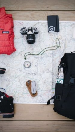 Travel accessories laid out around a map