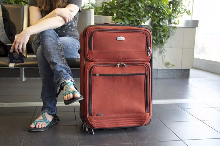 A soft sided suitcase is shown here