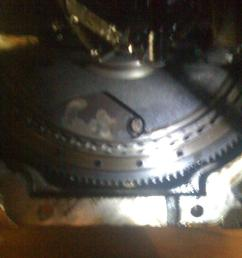 trying to unbolt driveplate from torque converter flywheel jpg [ 768 x 1024 Pixel ]