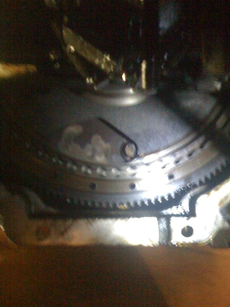 hight resolution of trying to unbolt driveplate from torque converter flywheel jpg