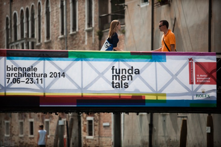 Venetian bridge with Biennale banner.