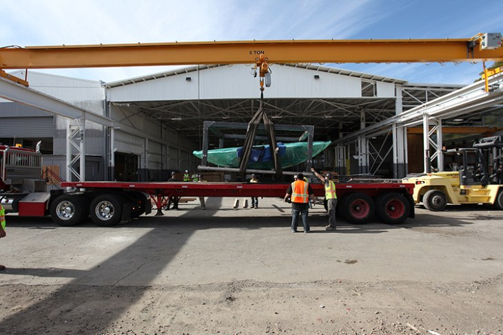 The cistern and its protective steel cage are readied for transport. Image courtesy of Concreteworks.