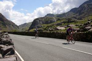 Lands End to John O'Groats - Image of 2 cyclists climbing