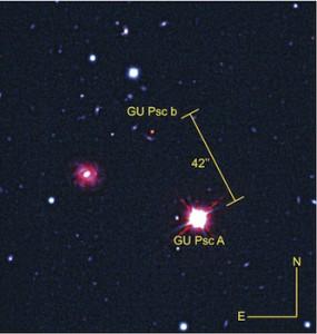 Bintang GU Psc dan exoplanet GU Psc b dalam cahaya inframerah yang dilihat Teleskop Gemini Selatan dan CFHT. Kredit: Observatorium Gemini