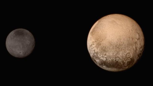 Pluto dan Charon. Kredit: NASA/JHUAPL/SWRI