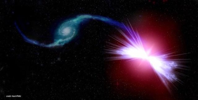 Lubang hitam supermasif sedang memberi makan galaksi tetangganya. Kredit: Kavli IPMU