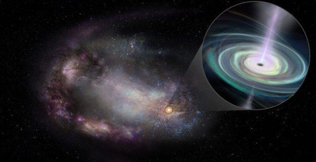 Ilustrasi galaksi katai yang bentuknya sudah mengalami perubahan akibat interaksi dengan galaksi lain di masa lalu, serta lubang hitam masif di pinggiran. Kredit: Sophia Dagnello, NRAO/AUI/NSF