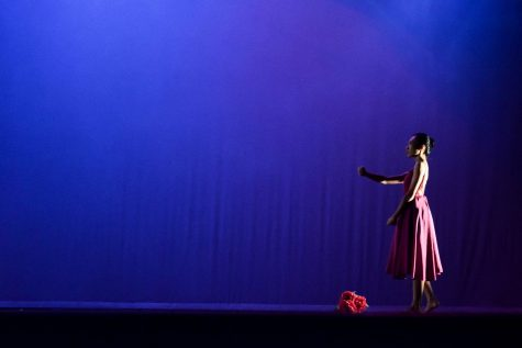Dancer Yap Chiw Yi in her long dress, gesturing words and thoughts beside her flowers, Experimental Theater University of Malaya, 3 May 2018. © Kwan Hoong.
