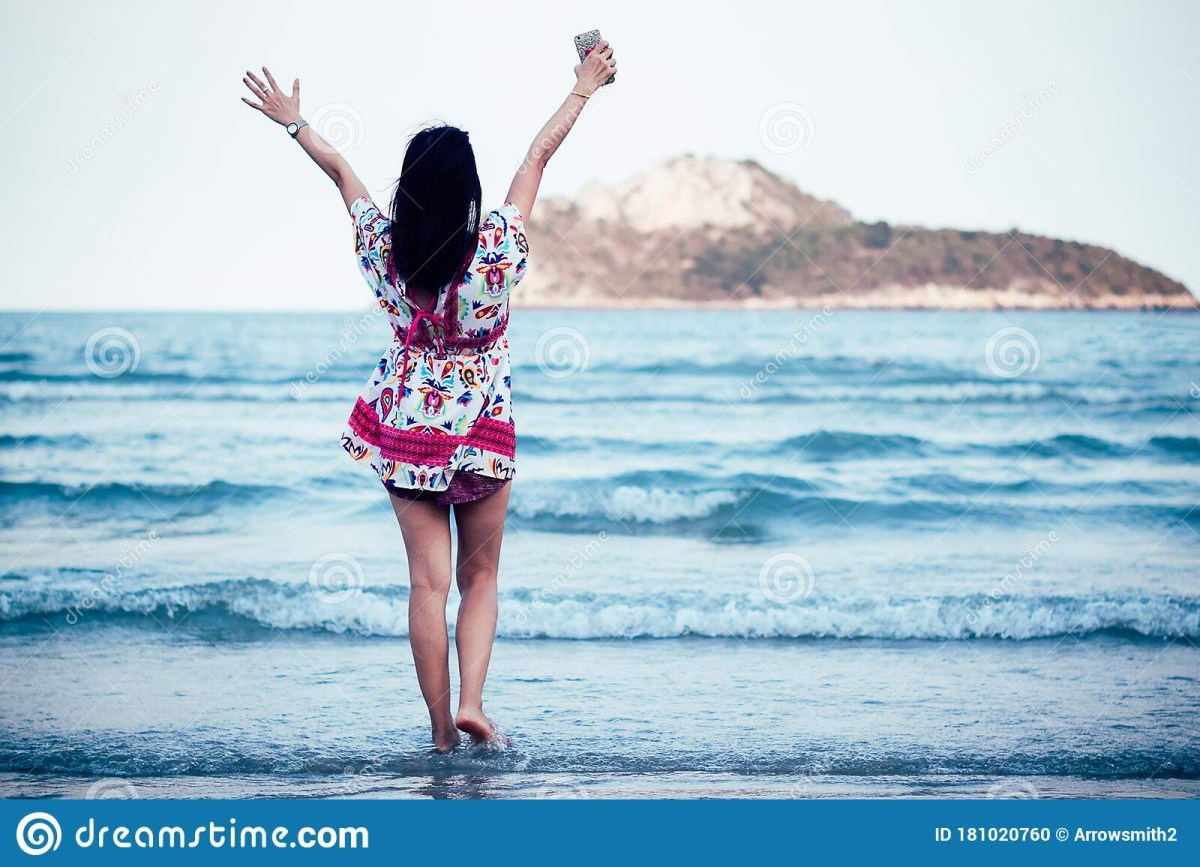 freedom asian smile woman in summer vintage dress on beach