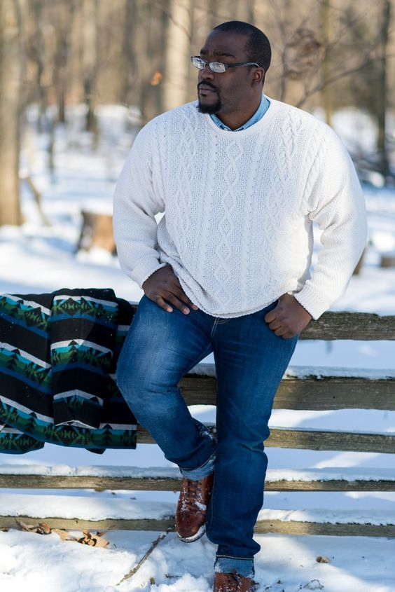 picture of blue jeans a blue shirt a white cable knit