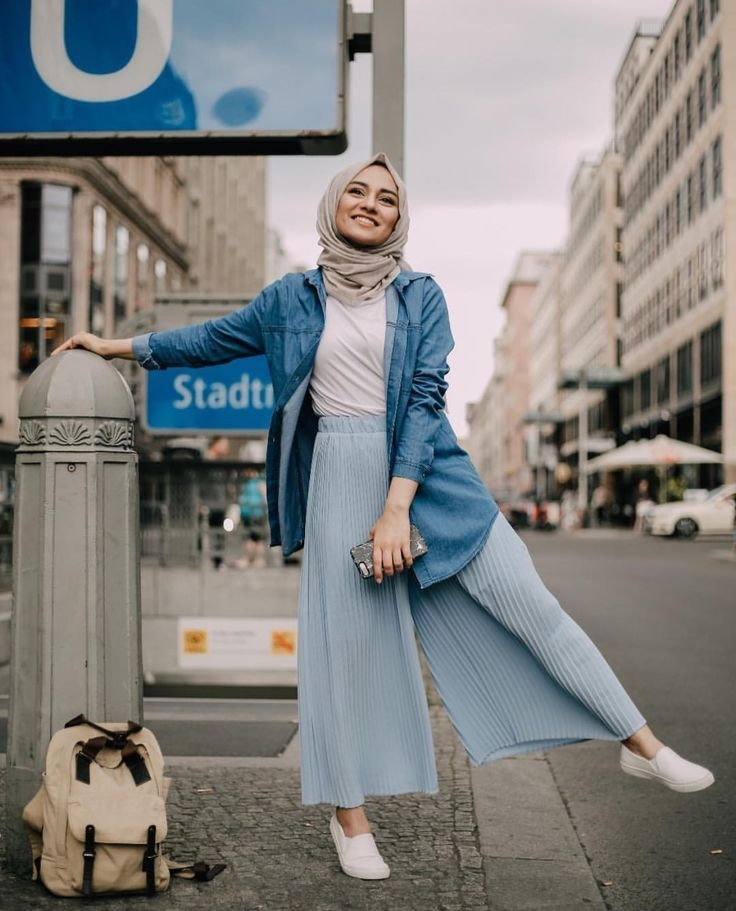 white top tucked in pastel blue pleated pants oversized