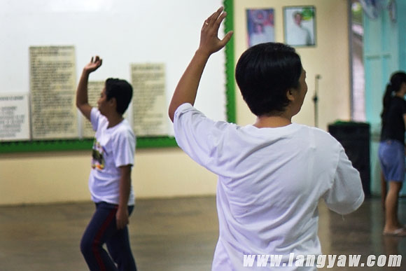 Government employees practicing a traditional dance number for an upcoming program