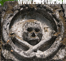 Skull and crossbones medallion at facade of Calamba cemetery