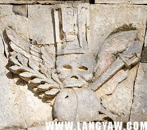 Skull with wings and other symbols at the top of the mortuary chapel entrance in Argao