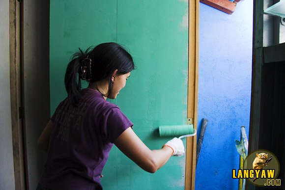 A volunteer putting a paint finish at a Gawad Kalinga project site in North Metro Manila