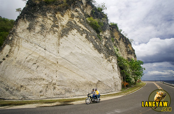 The white surface of a limestone cliff along the highway tells the traveller that he is nearing the old town of Boljoon. it is one of the scenic spots in the south.