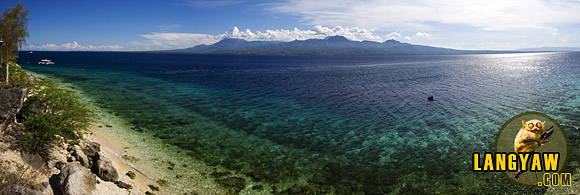 At the southern tip of Cebu, the familiar mountains of Southern Negros dominated by the Cuernos de Negros Mountains or Horns of Negros.