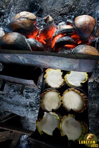 "Along the road, freshly fired and delicious ""bibingka"" is sold"
