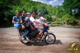 Habalhabal motorcycles with four passengers. Its the common mode of transport in Tuburan and the vehicle to hire when going to Marmol Cliff.