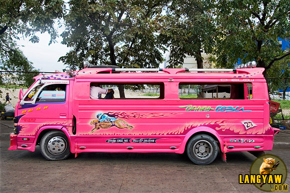 Bright and bold, a typical jeepney in Cebu sporting colorful paint and images