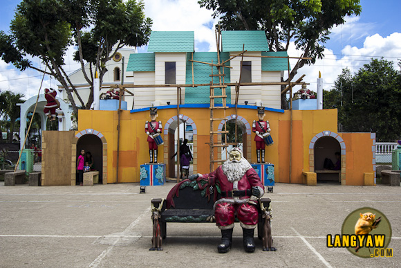 A seating Santa is just one of several sculptures that abound in the town plaza of Mulanay, Quezon