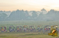 Tricycles outside the Sanga-sanga airport in Tawitawi, early in the morning waiting for arriving passengers from Zamboanga City.
