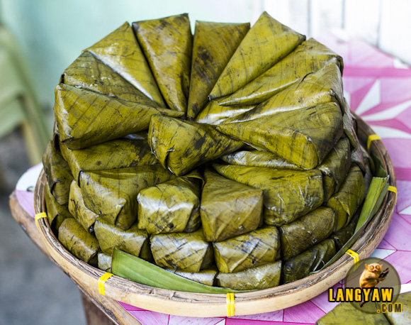 A pile of suman, a type of native rice cakes. I really stopped and bought one to taste and eat.