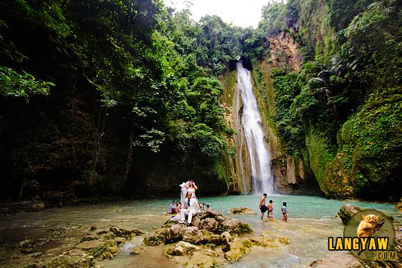 Newlyweds on a photoshoot in Mantayupan Falls, Barili